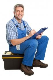 plumbing contractor in Bedford sitting on a toolbox